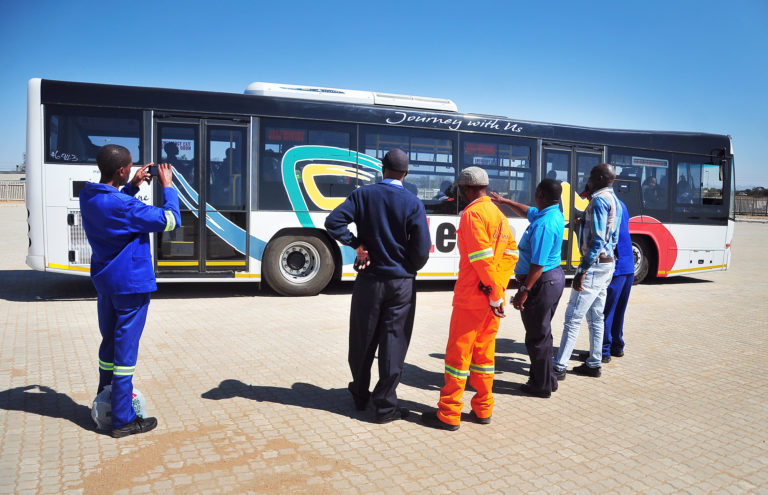 Technical employees discussing the Leeto bus service